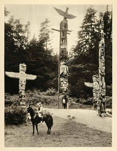 totem poles at vancouver's stanley park 1935 ~