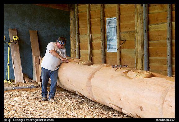 artist carving a totem pole. butchart gardens, victoria ~