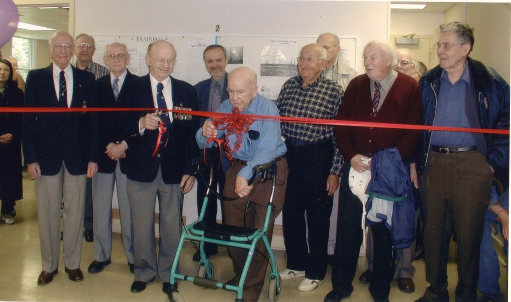May 24, 2003 Ribbon cutting at the newly opened Secrets of Radar Museum.  Pictured L-R: Albert James, unknown, James Sands, Donald Harrett, Bob Wood (MPP), G. Fred Bates, David Meltzer, John Callingham, James Henderson, Clark Aylward, Roy Taylor