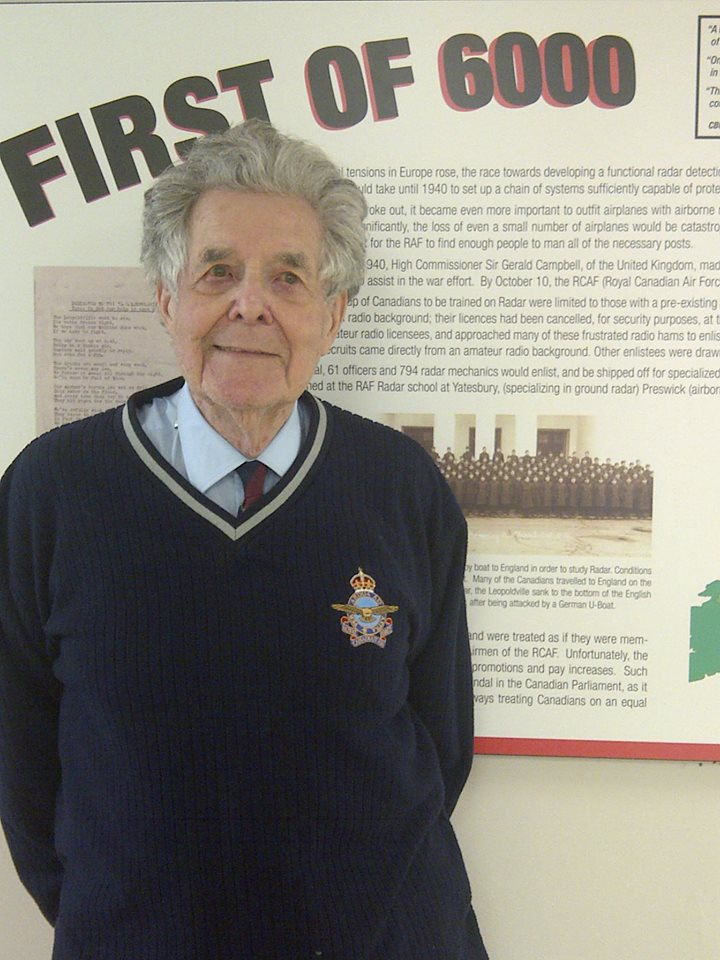 RoyTaylor (2013) stands in front of his 1940 enlistment group photo.