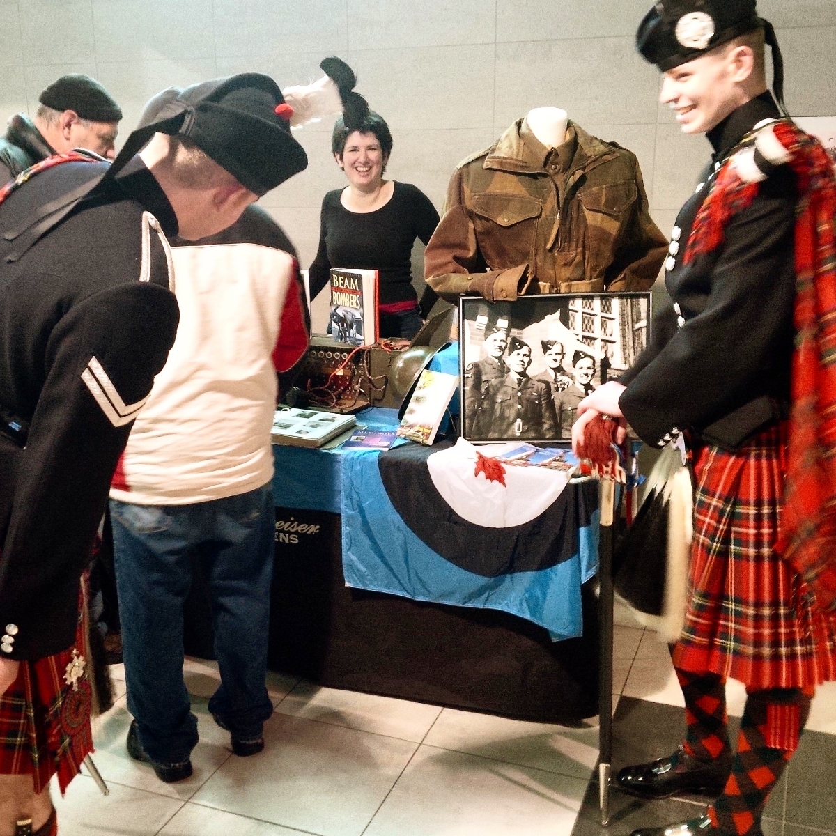 Two Highland dancers of the 1st Batalion Scots Guard visit the display.