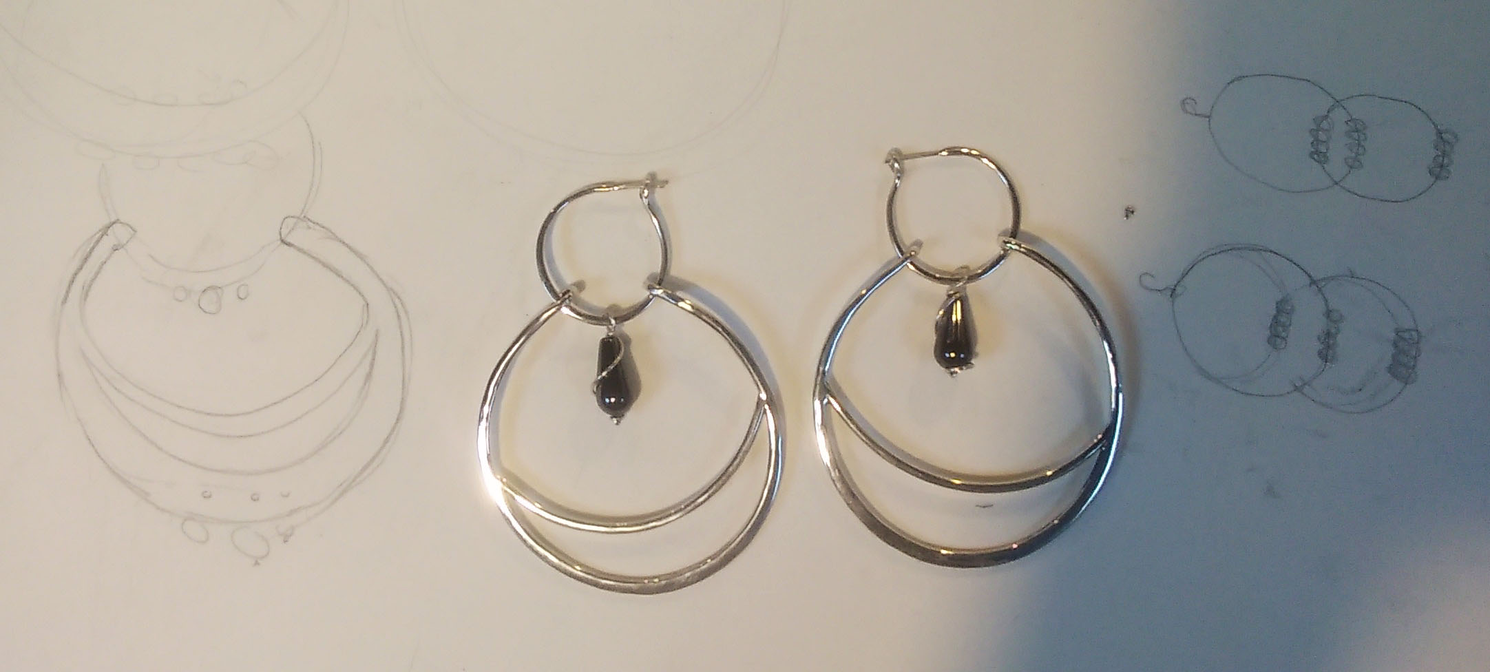 Silver hoops made by first time silver smithing student.