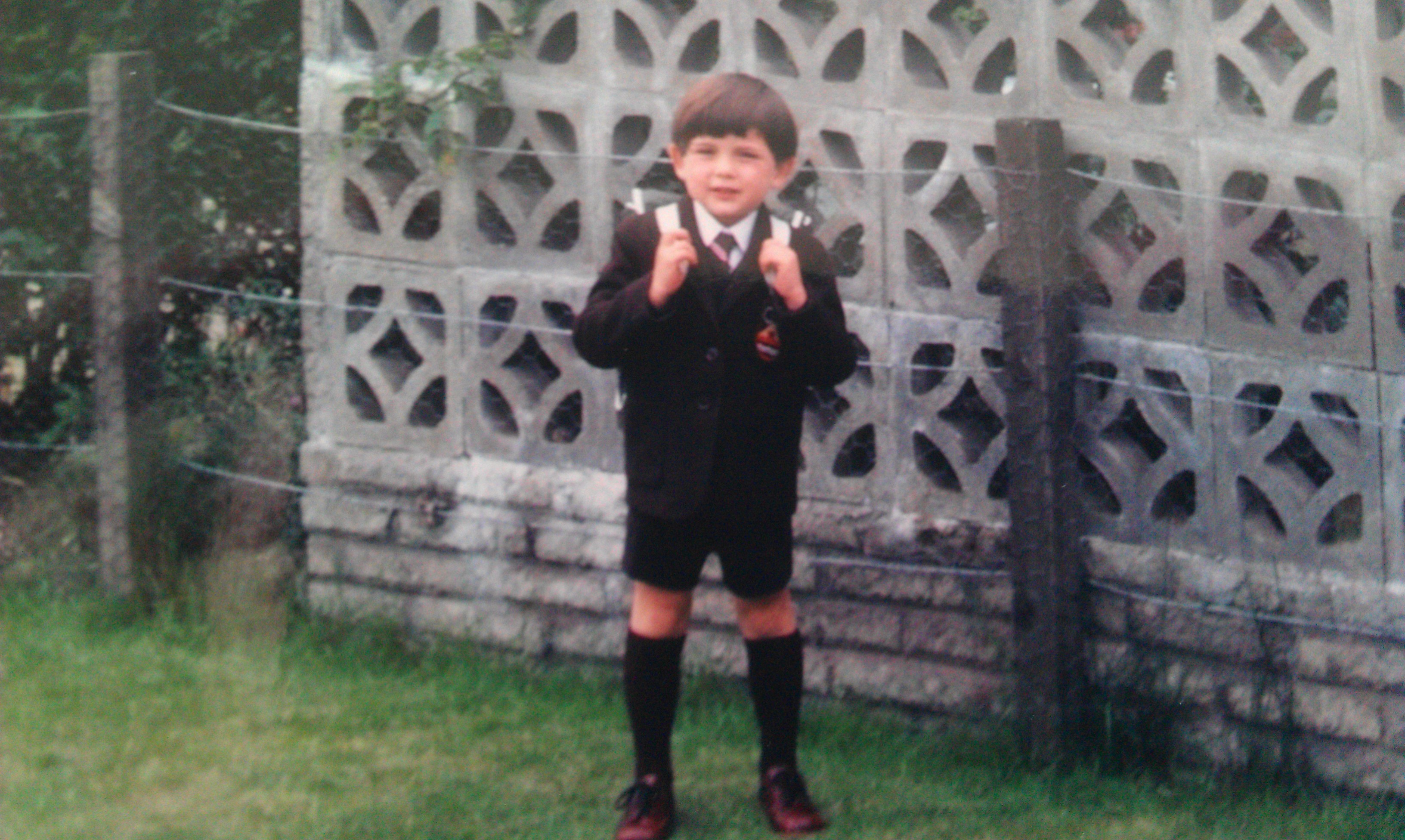Clive,when he was a whole lot younger, posing on his first day of school in Clydebank, Scotland.