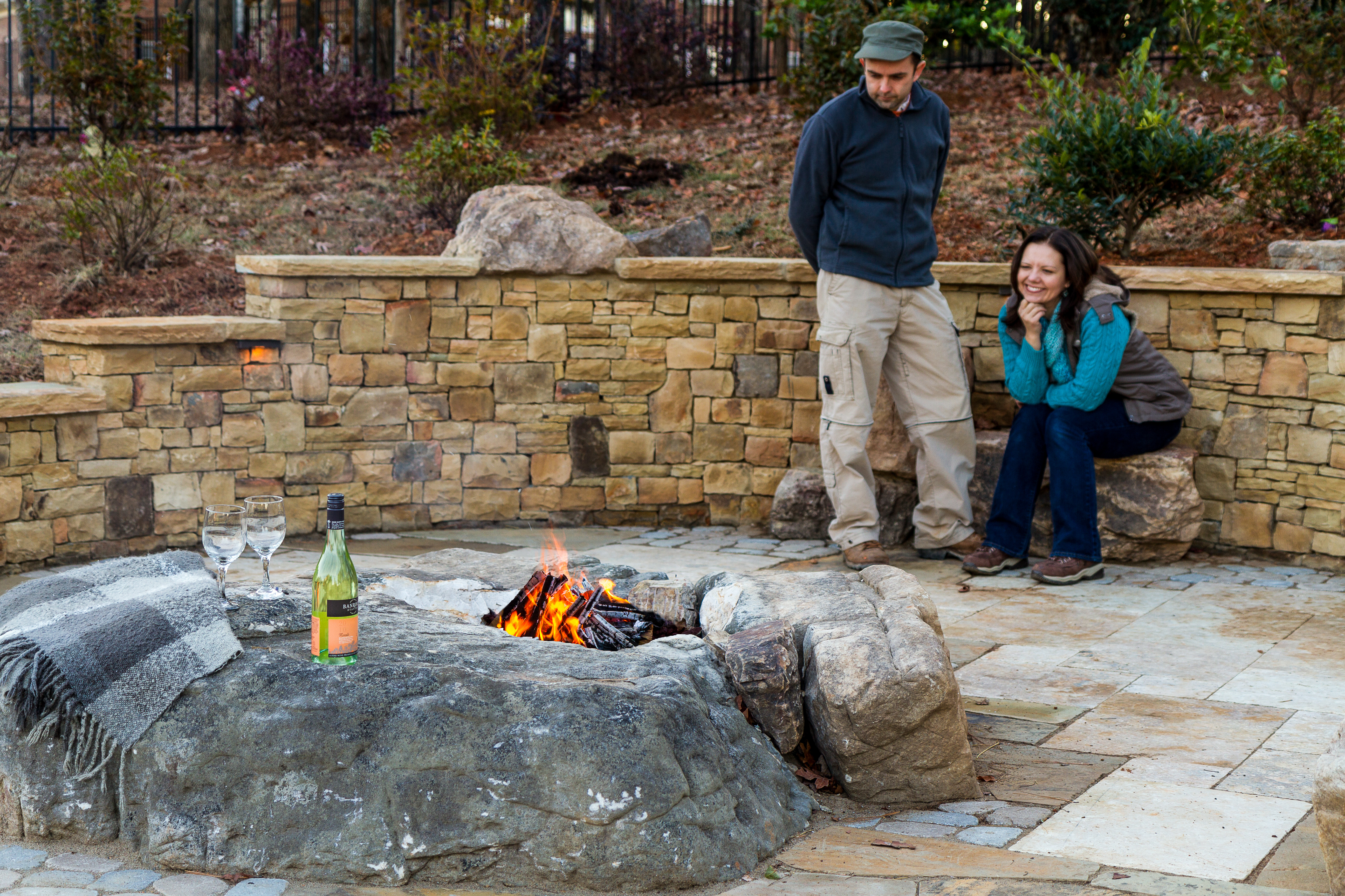 Clive and Tracie,checking out themost recent custom fire pit, designed and installed by Outdoor Artisan, Inc.