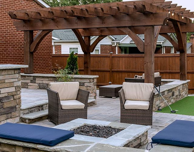 Here's a close up of the fire pit seating area. We promise to turn the gas key soon so you can see this pit in it's full glory!🔥 . . This multi-level outdoor living space designed by Josh Smith, a talented landscape designer, and our most recent hire. Installed by the @outdoorartisan team. Photo by @brucesaundersphotography. . . . #brucesaundersphotography #outdoorartisan #charlottehomes #techobloc #patios #patio #backyardgoals #outdoorspaces #outdoorroom #pergola #pergolas #flagstone #backyarddesign #backyardideas #backyards #firepit #firepits #patiofurniture #patiodecor #outdoorlivingspace #outdoorspace #outdoordecor #backyardliving #patiogarden #outdoordesign #outdoorentertaining #patiodesign #patioseason #pavers #patiolife