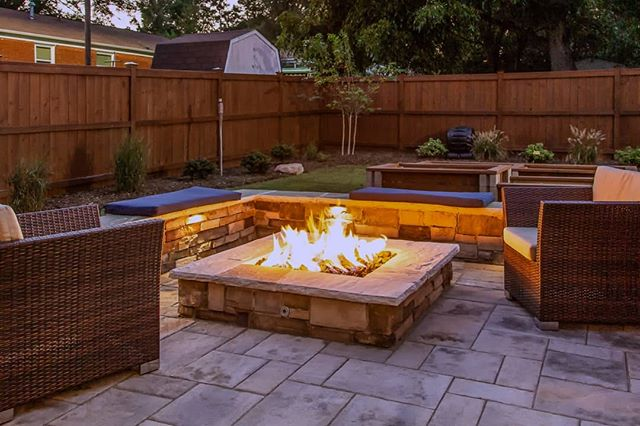 Friday bonus picture of the same project we've been featuring all week! This gas fire pit has great flames, and zero ash cleanup! 🧡 We've noticed a trend towards more of our clients choosing the convenience of gas fire pits, over classic woodburning. They prefer to just turning it on whenever they want . . . and not having to mess with buying firewood, keeping the fire going, ash clean up, and the inevitable charred-wood smell in their hair. 🔥However, we still get a few wood-burning diehards that love the crackle of a wood fire, and enjoy throwing trash in to watch how it burns. . . . #brucesaundersphotography #outdoorartisan #techobloc #outdoorspaces #outdoorroom #outdoorfireplace #charlottehomes #firepitnight #backyardgoals #backyardbliss #homeandgarden #backyarddesign #backyardideas #backyards #firepit #firepits #gasfirepit #outdoorentertaining #outdoorspace #patiodesign #patios #patio #outdoorlivingspace #hardscapes #hardscaping #designbuild #exteriors #landscapedesign #landscapersofinstagram #outdoorlighting