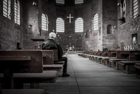 man sitting in chapel.jpg
