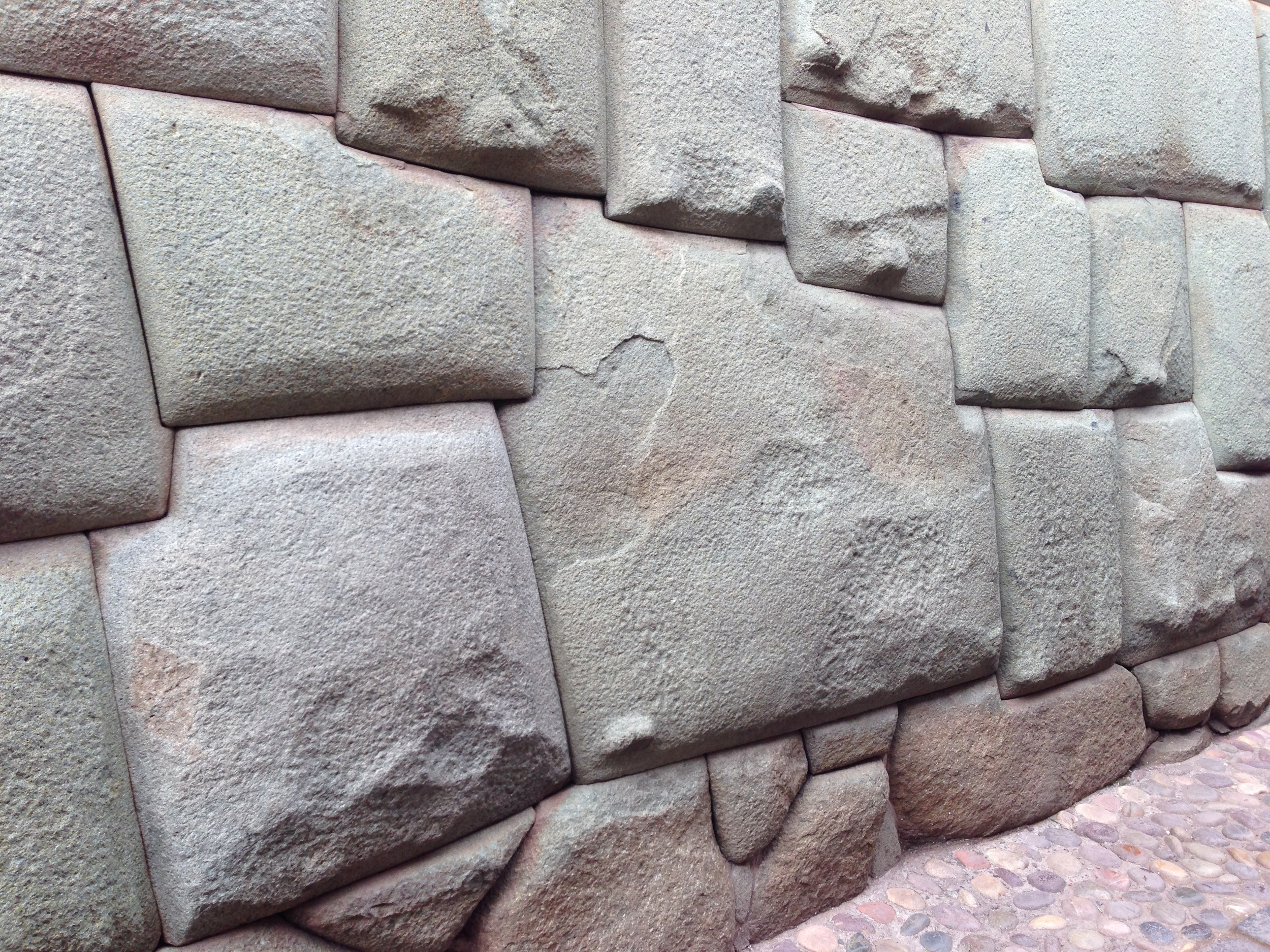 The famous 12-sided stone in an Incan wall in Cusco, Peru