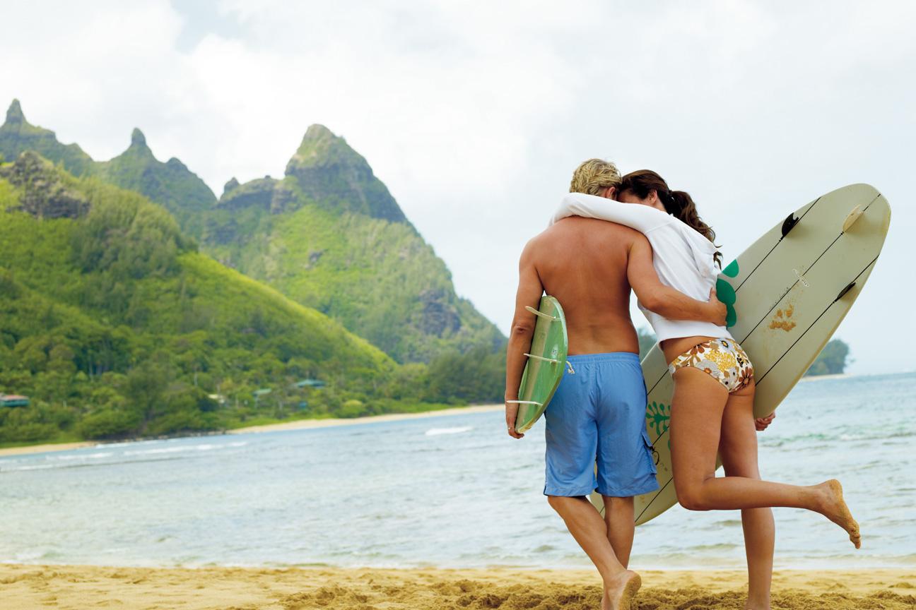 Couple_Walking_Beach_Surfboards_Secrets_Beach_Kauai.jpg