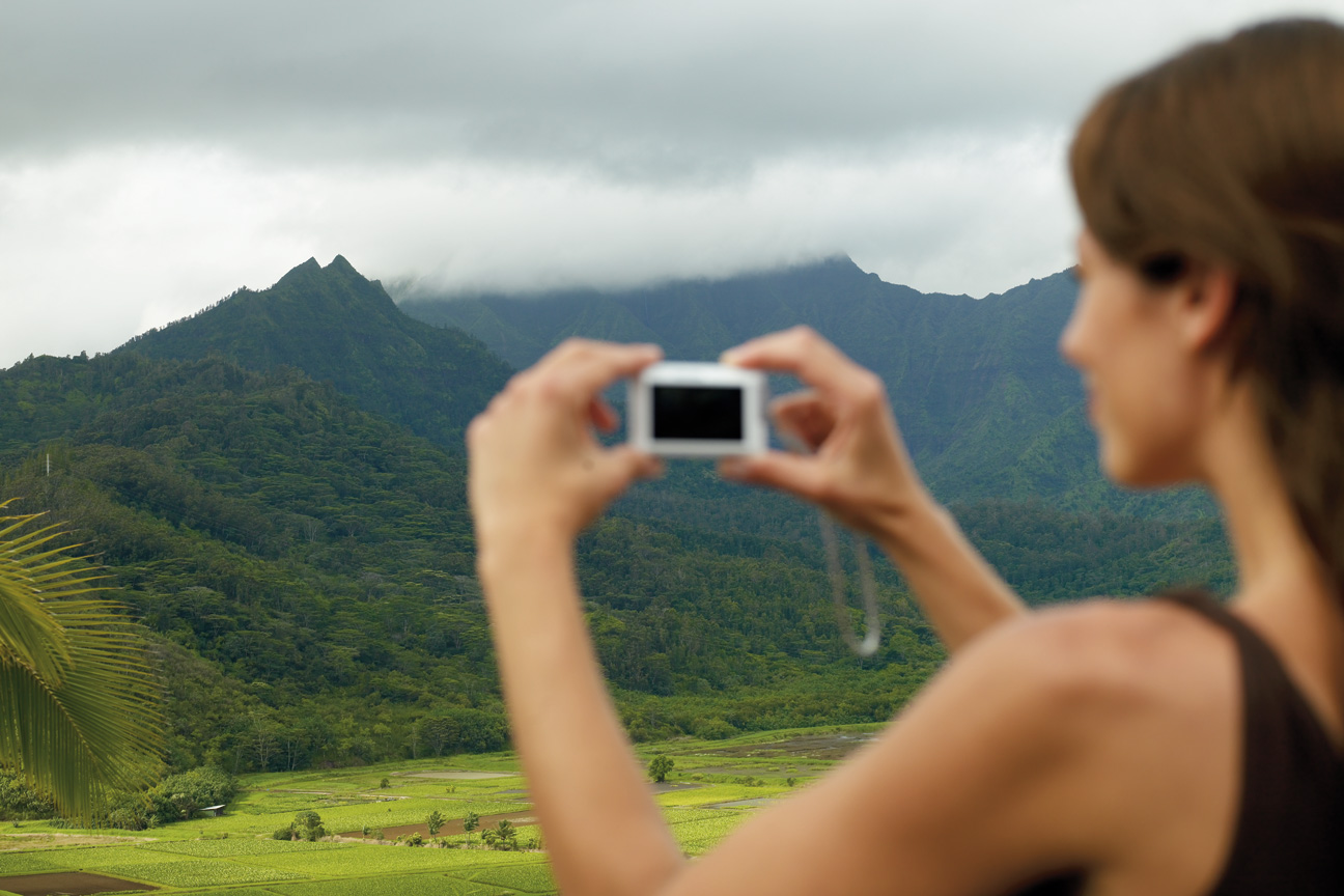 Woman_Taking_Photo_Mountains_Kauai_Hawaii.jpg