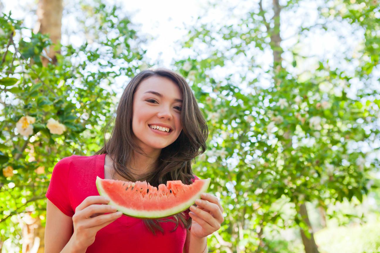 Woman_Eating_Watermelon_Slice.jpg