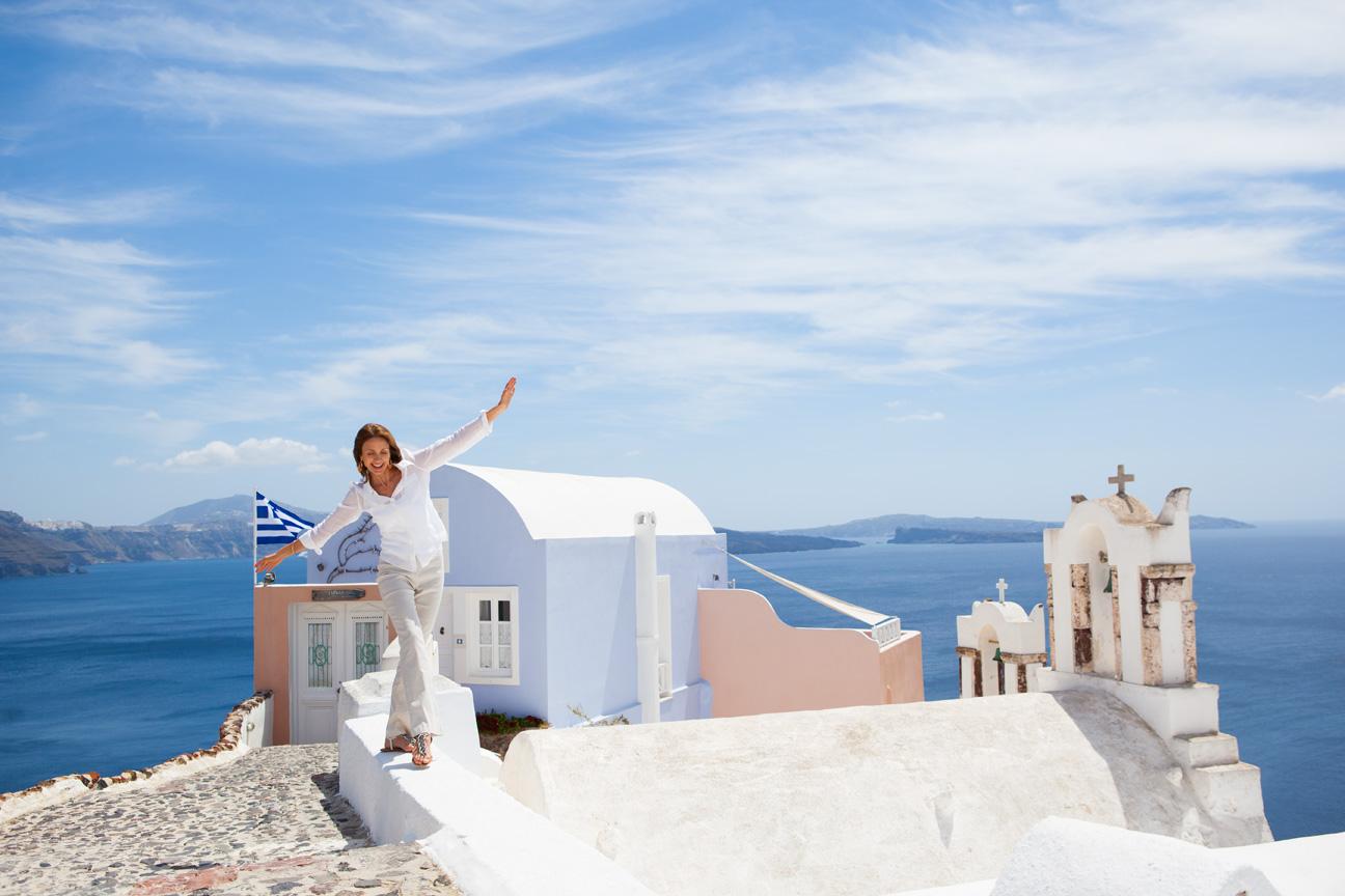 Woman_Tourist_Playing_View_Santorini_Greece.jpg
