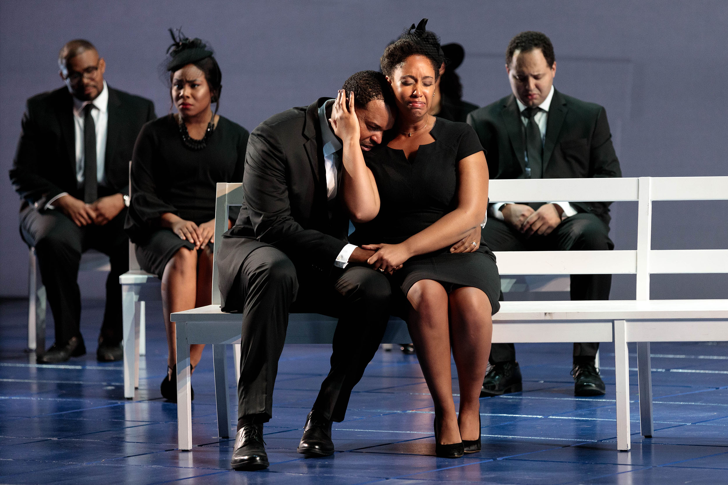 """(Front) Kenneth Kellogg as The Father, Briana Hunter as The Mother and members of the ensemble in The Glimmerglass Festival's 2019 world premiere of Jeanine Tesori and Tazewell Thompson's """"Blue."""""""