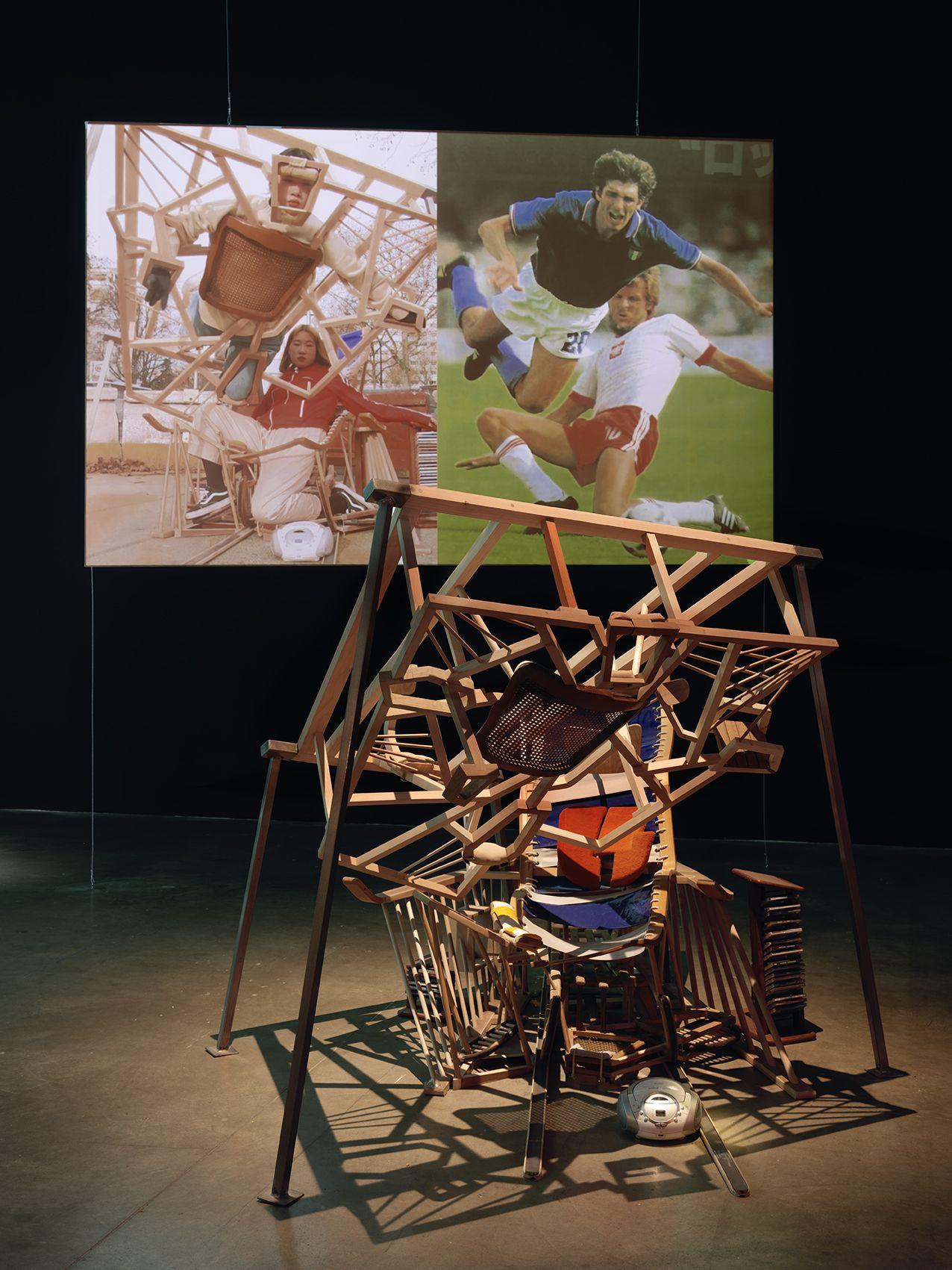 Izumi re-imagines a tackle by Poland's Stefan Majewski on Italian star Paolo Rossi in the 1982 FIFA World Cup semi-final.