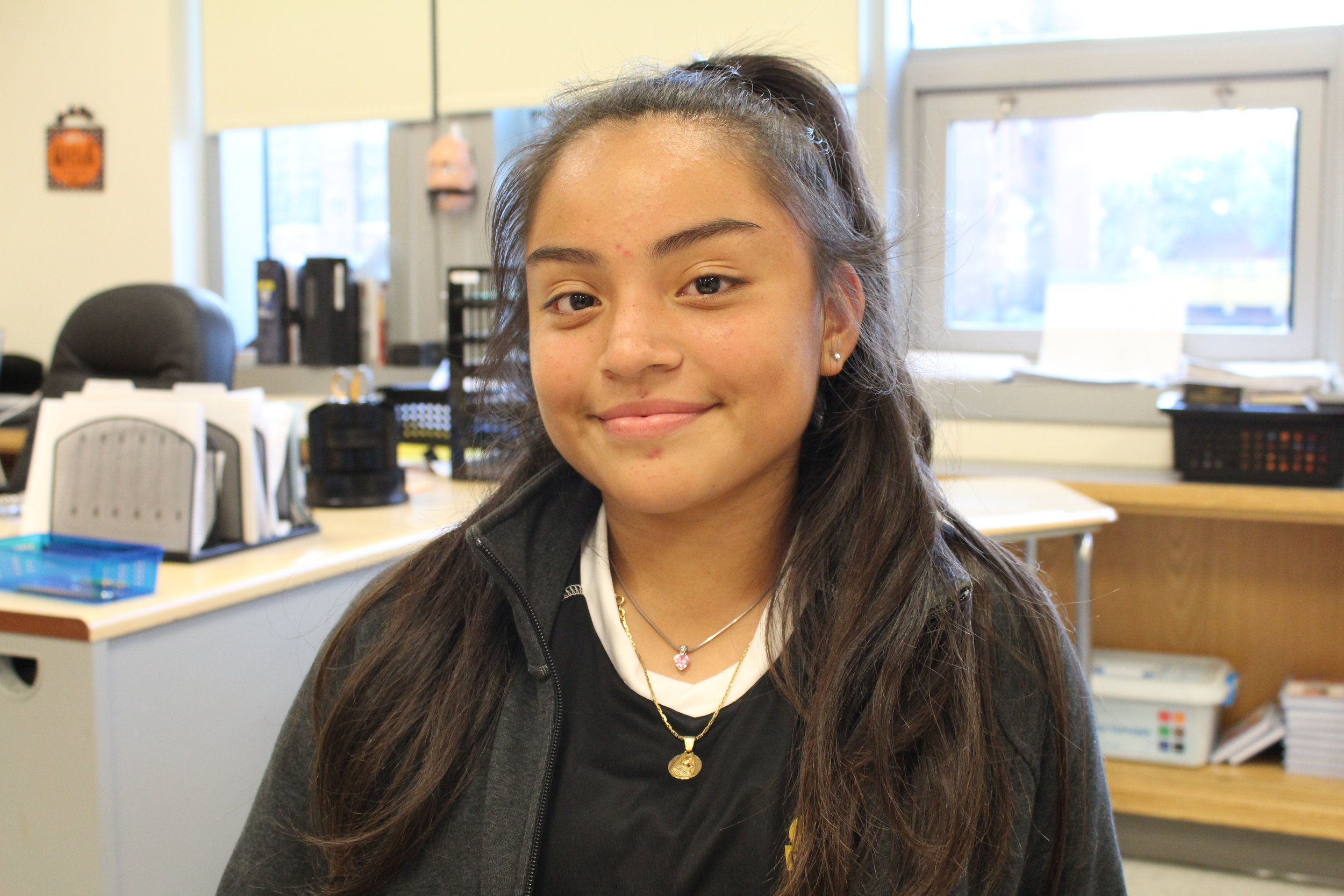 Sitting in the school that she attends as a high school freshman and as a participant of South Bronx United's educational program, Meredith, 15, described the role of her late father in her embrace of fútbol.Kervy Robles for After the Final Whistle.