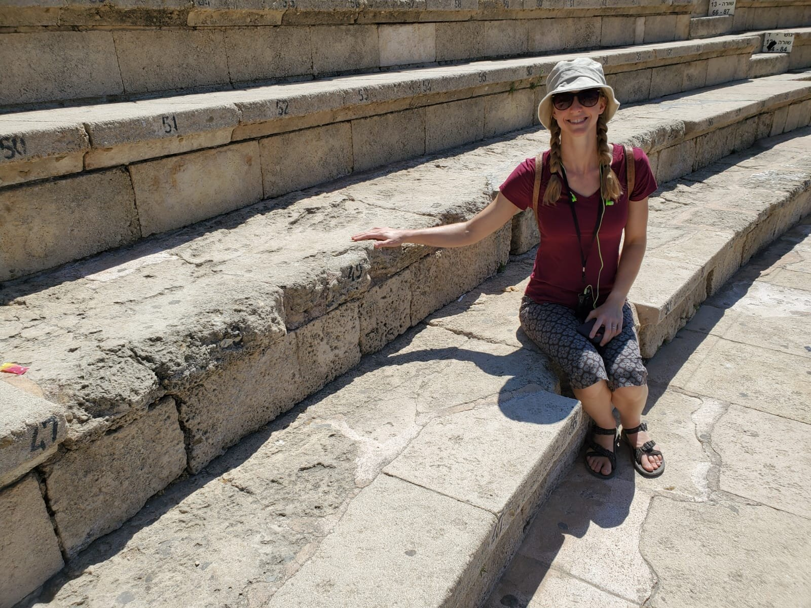 Touching original stones in the theater where the Angel of God struck down Herod Agrippa in Acts 12