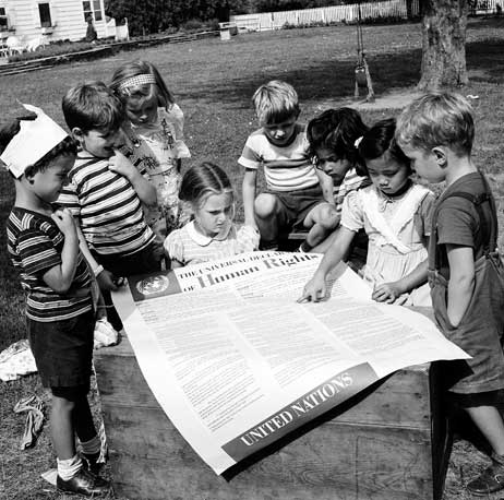 Children reading the universal declaration of human rights (via  un photo )