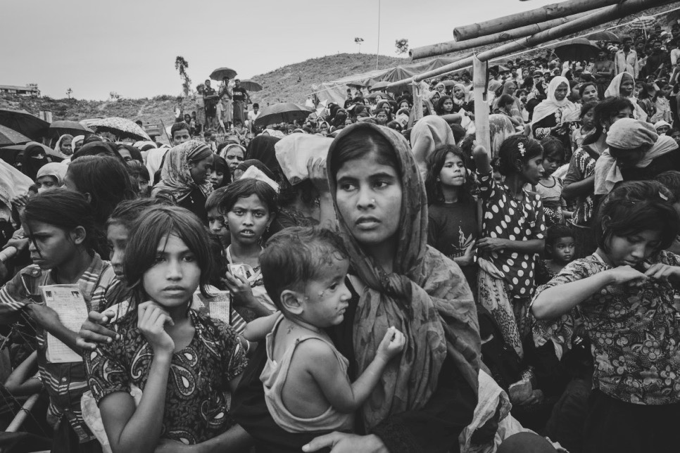 Rohingya refugees Hamida and her son Mohammed wait to receive food at a Refugee Camp in Bangladesh (via  UNHCR/Andrew McConnell )