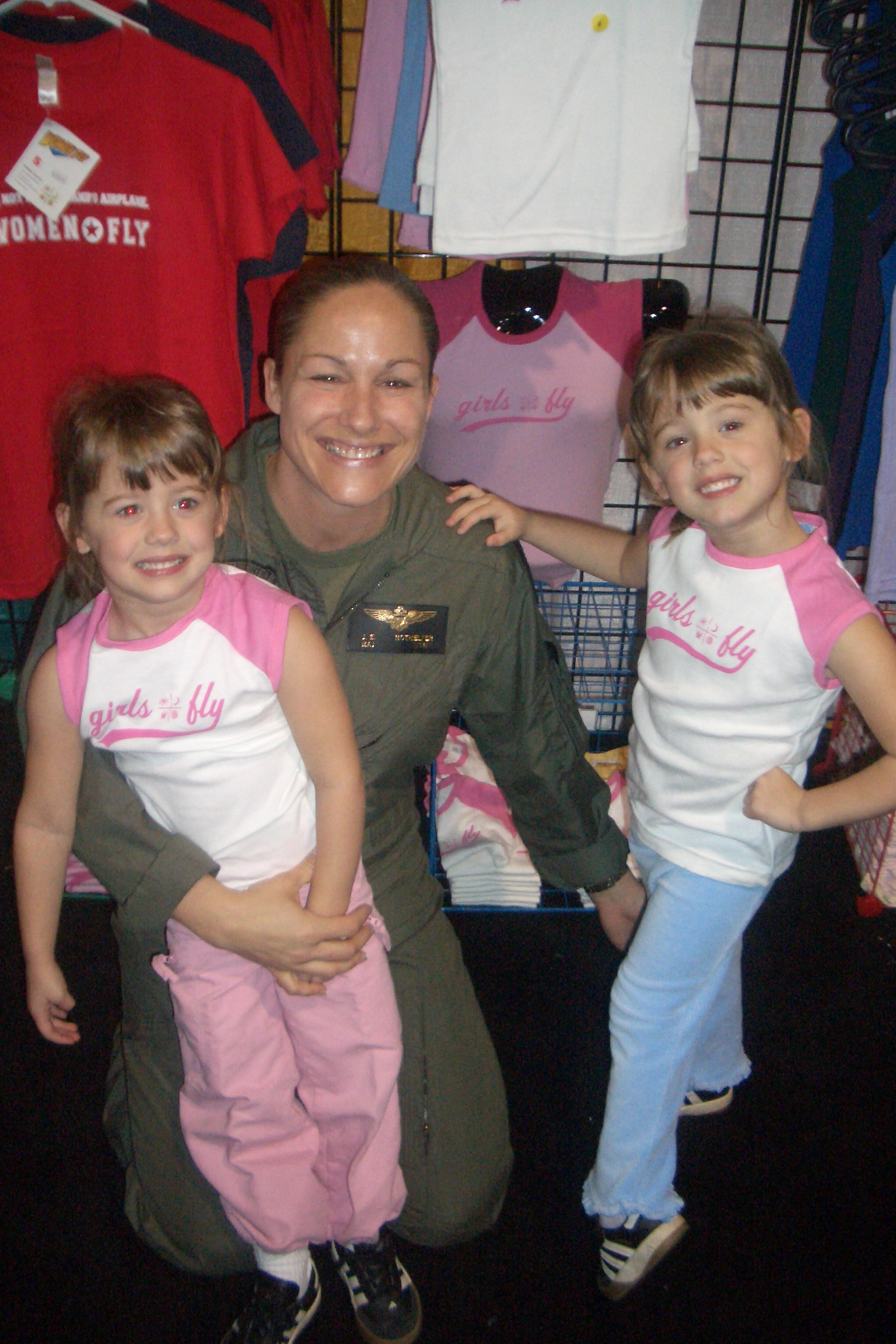 The softer side of grit: USMC officer Nothelfer with her twin daughters Bridget, left, and Alexis