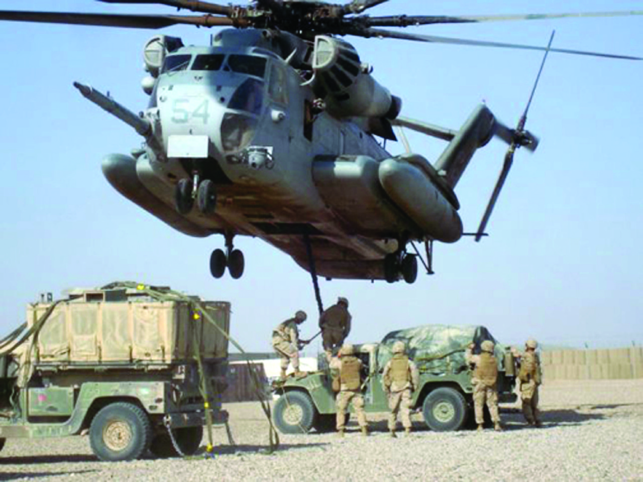 A USMC CH-53E doing sling load operations in Afghanistan in support of Operation Enduring Freedom