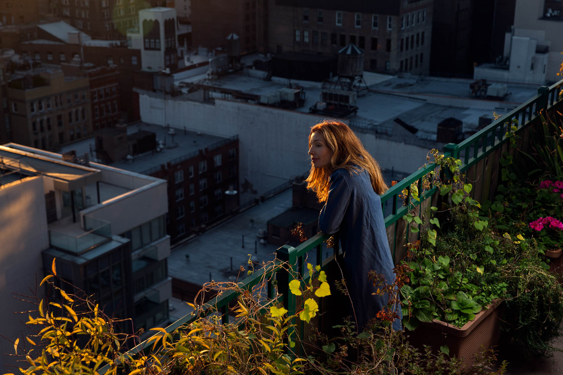 Environmental portrait on a rooftop New York City by Martin Adolfsson