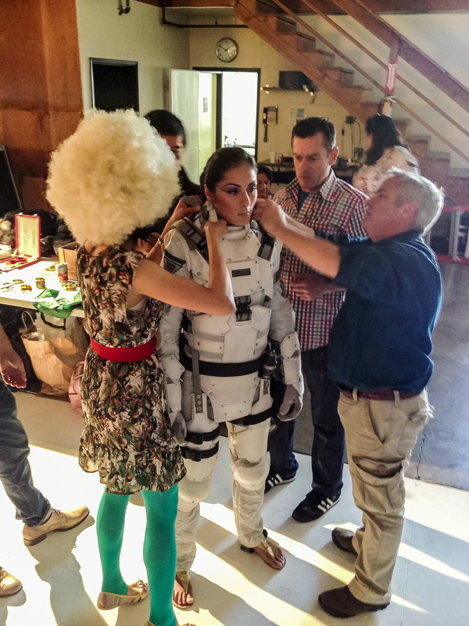 Everyone lends a hand when fitting talent in storm trooper body armor
