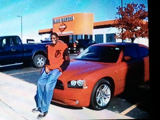 Tommie Seals, Renay's son, with the 2006 Dodge Charger the day after Renay purchased it from Mak Cars, Inc. Tommie and Renay would learn the truth about the car—that it had at least 245,000 miles on it and was not eligible for an extended warranty—a month later.