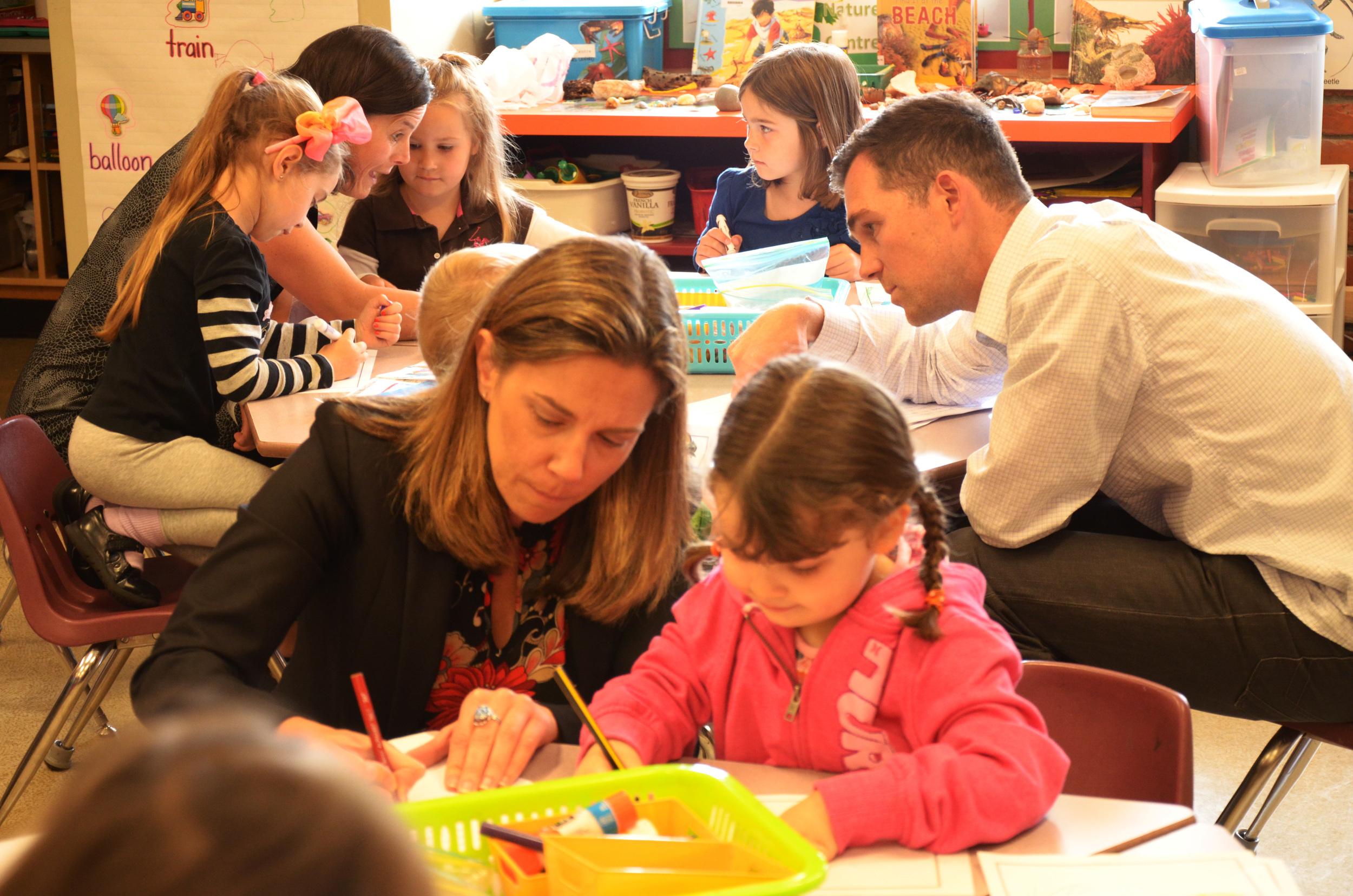 Tammara Kennelly (President of FriesenPress) & Brian Friesen (Sales & Marketing Manager) helping kids
