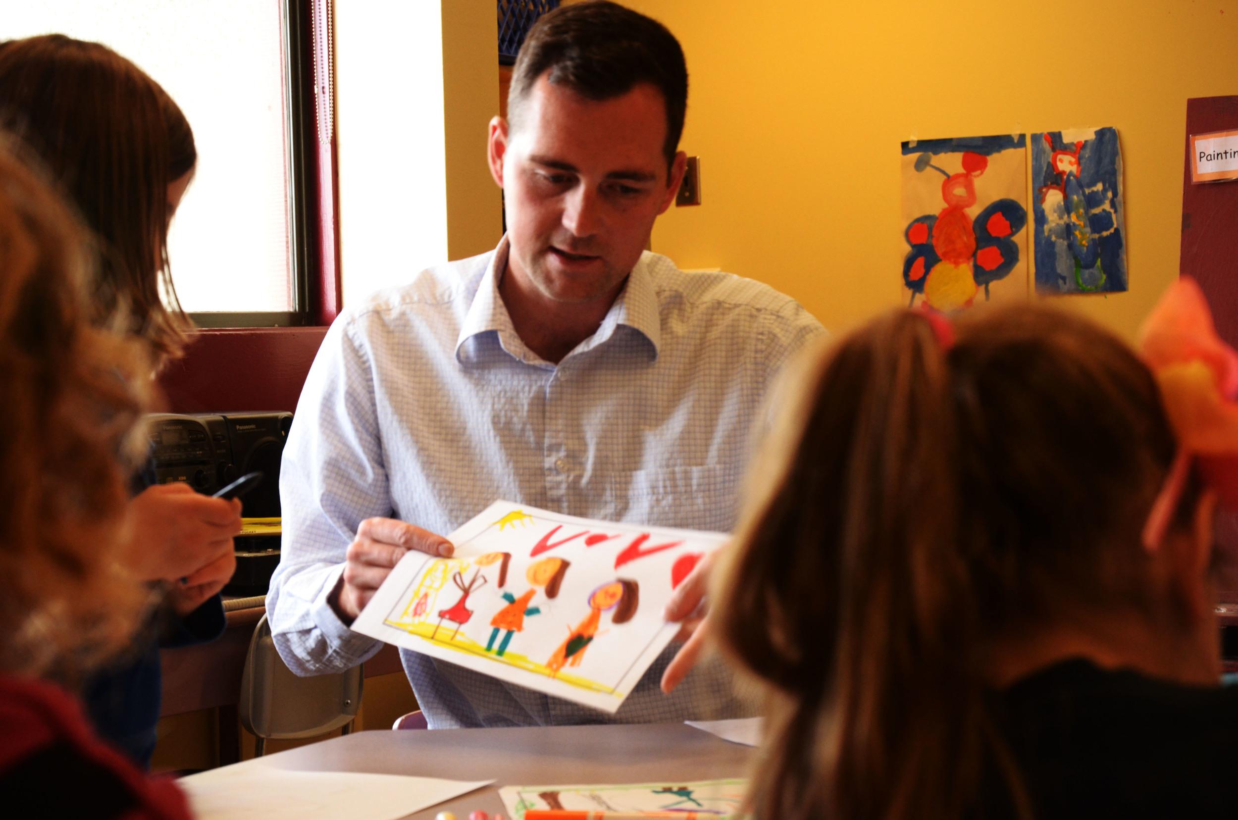 Brian Friesen helping out kids