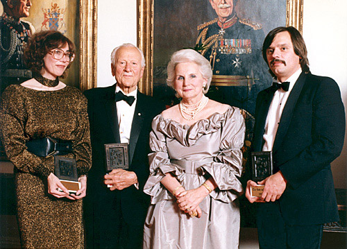 Co-Winners of the 1985 Michener Award. Left to Right: Olivia Ward, reporter Toronto Star; former governor general Roland Michener; Governor General Jean Sauvé; Victor Malarek, the reporter, the Globe and Mail.