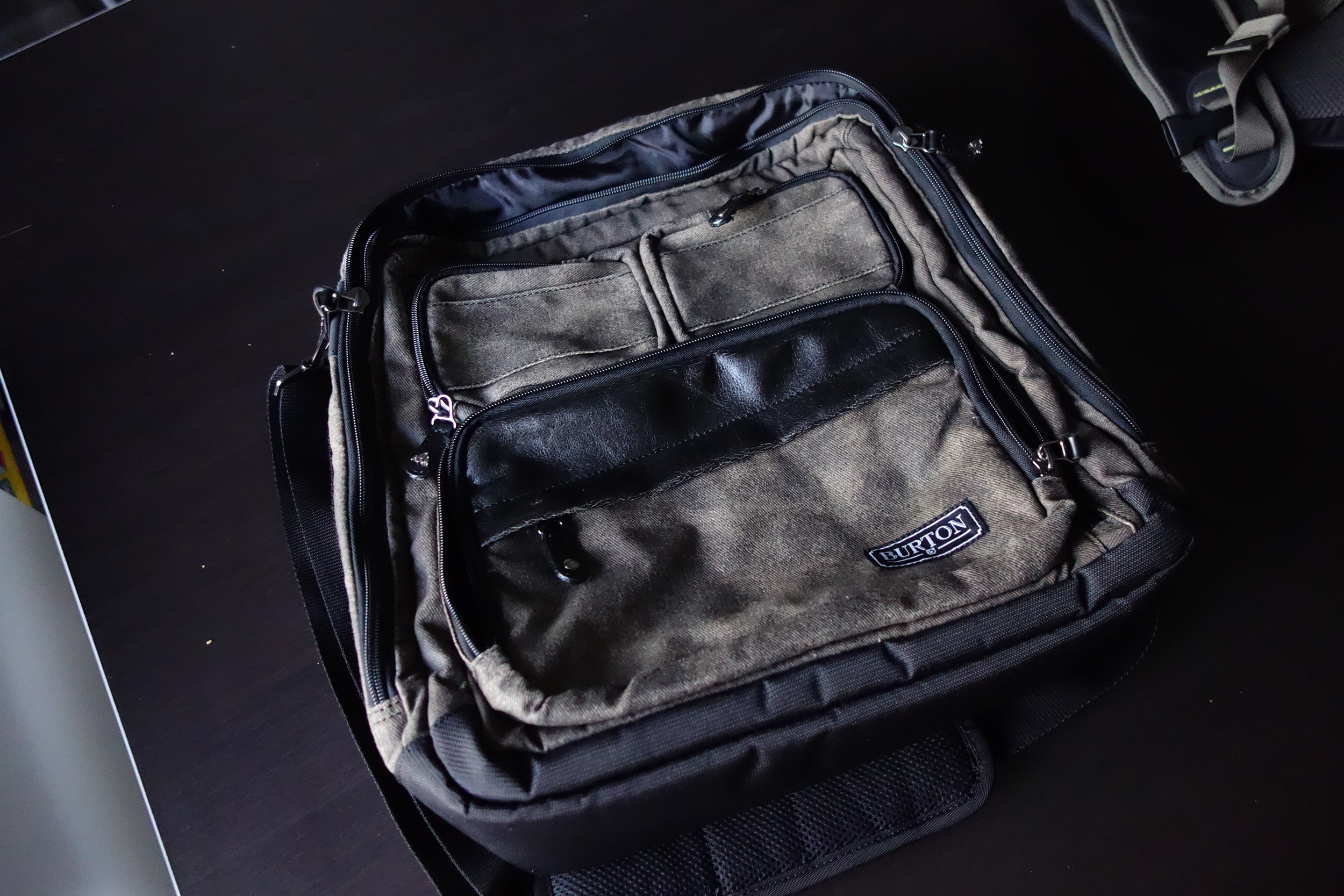 "Burton DJ Bag // $35 Fits a 15"" MBP Retina, but better suited for a 13"".  Can convert into a backpack with hidden straps!"