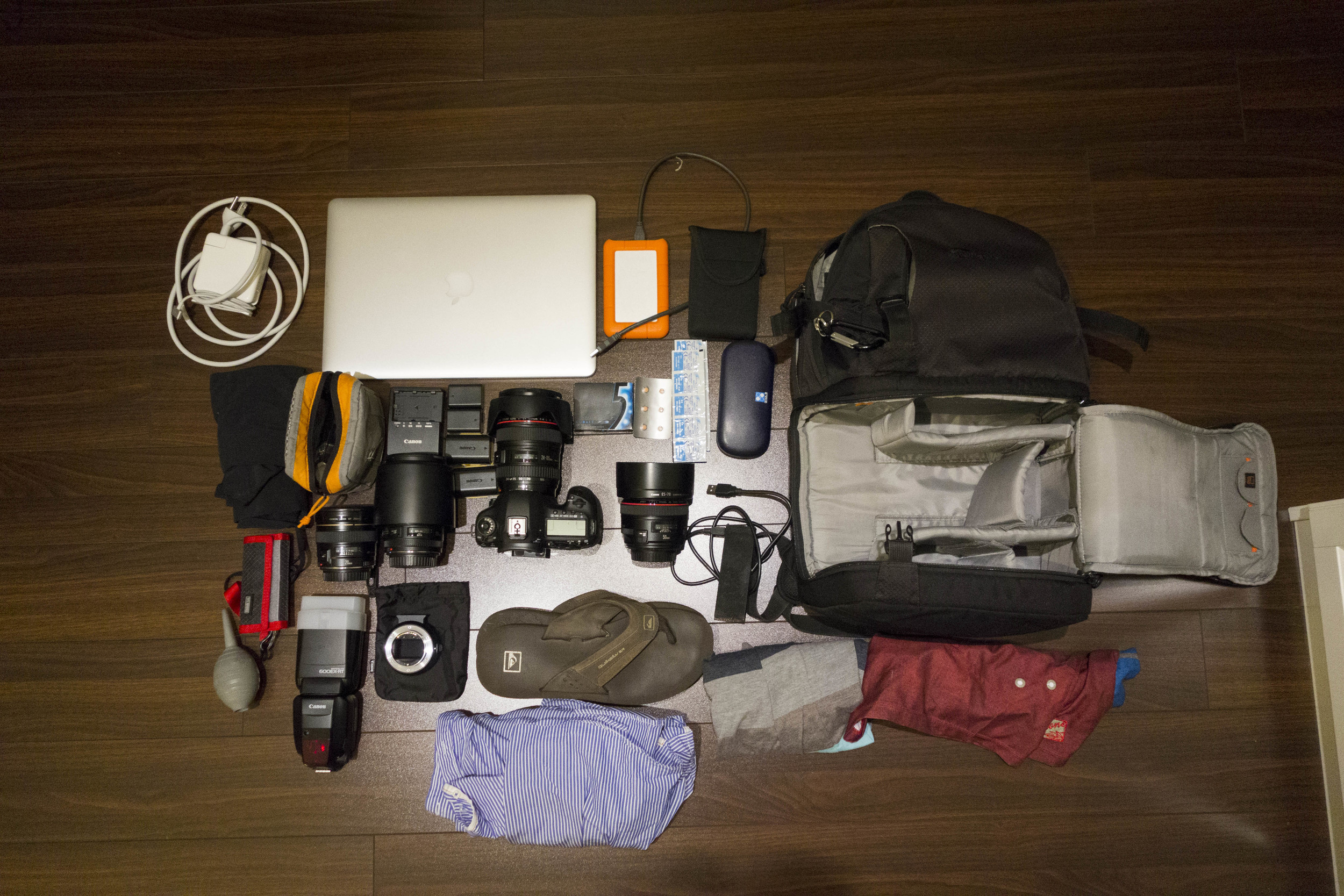 Lowepro DSLR Fastpack 250 AW  - Macbook Pro - MBP Charger - Lacie Rugged External Drive - Hyperdrive - Canon 5D Mark III - 3 Batteries - Charger - 24-105L - 50mm f1.2L - 20mm f2.8 - 135mm f2.0L - 600 EX Speedlight - Puffer - Thinktank Card pouch with extra CF and SD cards - Card reader - 2 Sony A7 batteries - Glasses - Pepcid AC - Contacts - 2 Shirts - 2 Shorts - Sandals