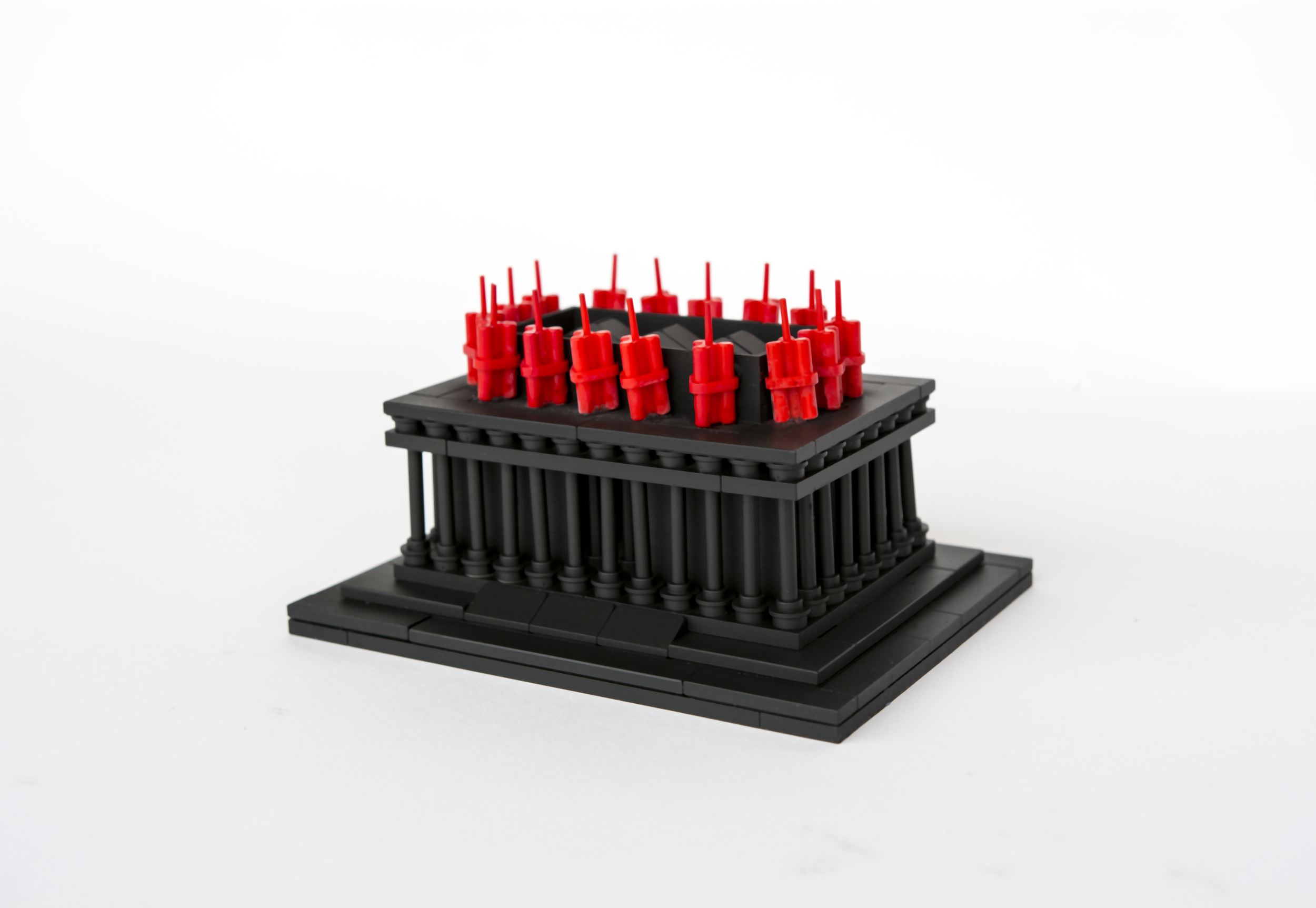 """Anti-Monuments for Counter Histories (09/05/1970) , painted lego pieces and plastic dynamite,2"""" (6cm) tall, 4"""" (12cm) wide and 3"""" (9cm) deep,2015"""