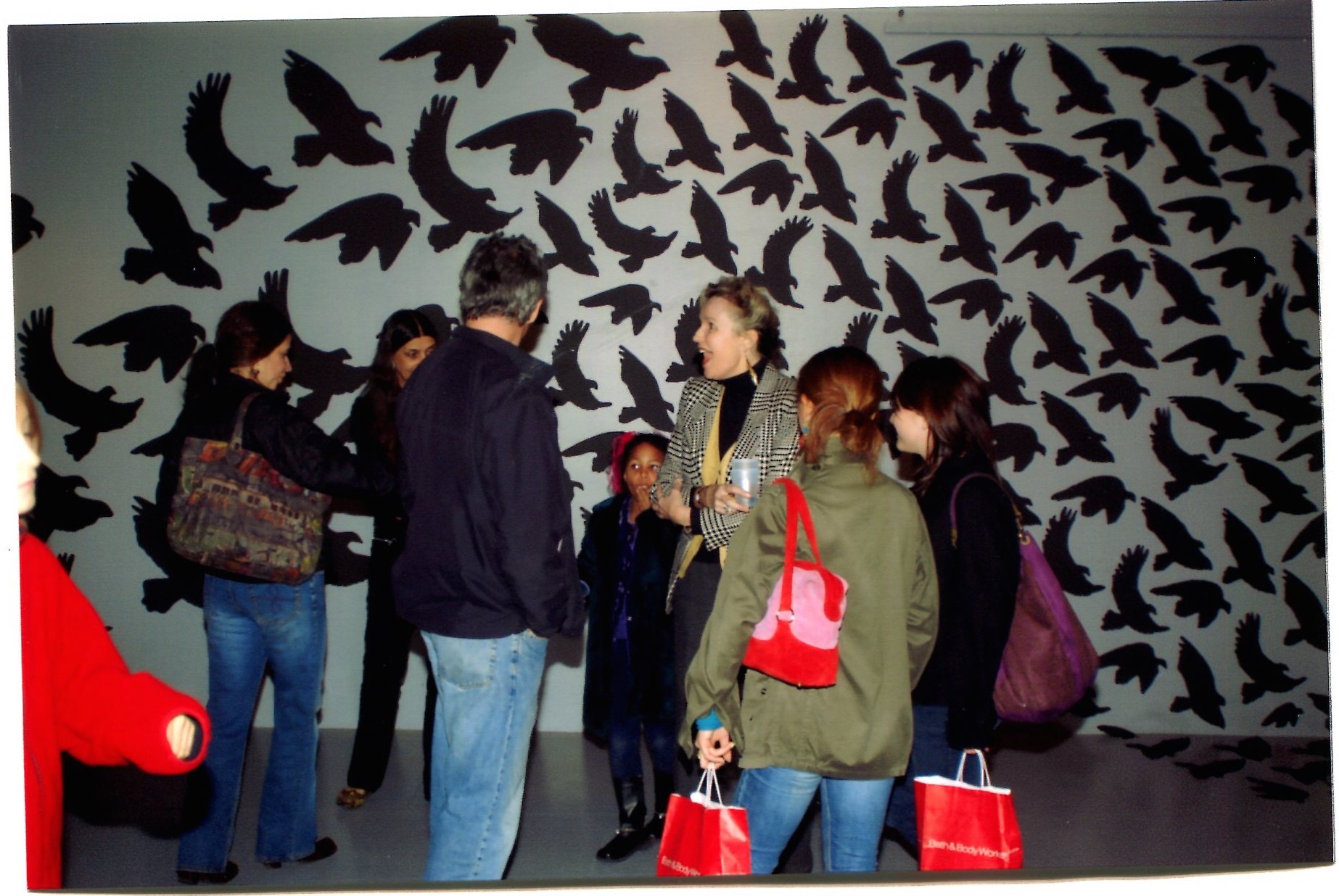 The opening for Maura Sheehan's exhibition,  Night Flight , an installation of hundreds of paper cutouts. 2005.