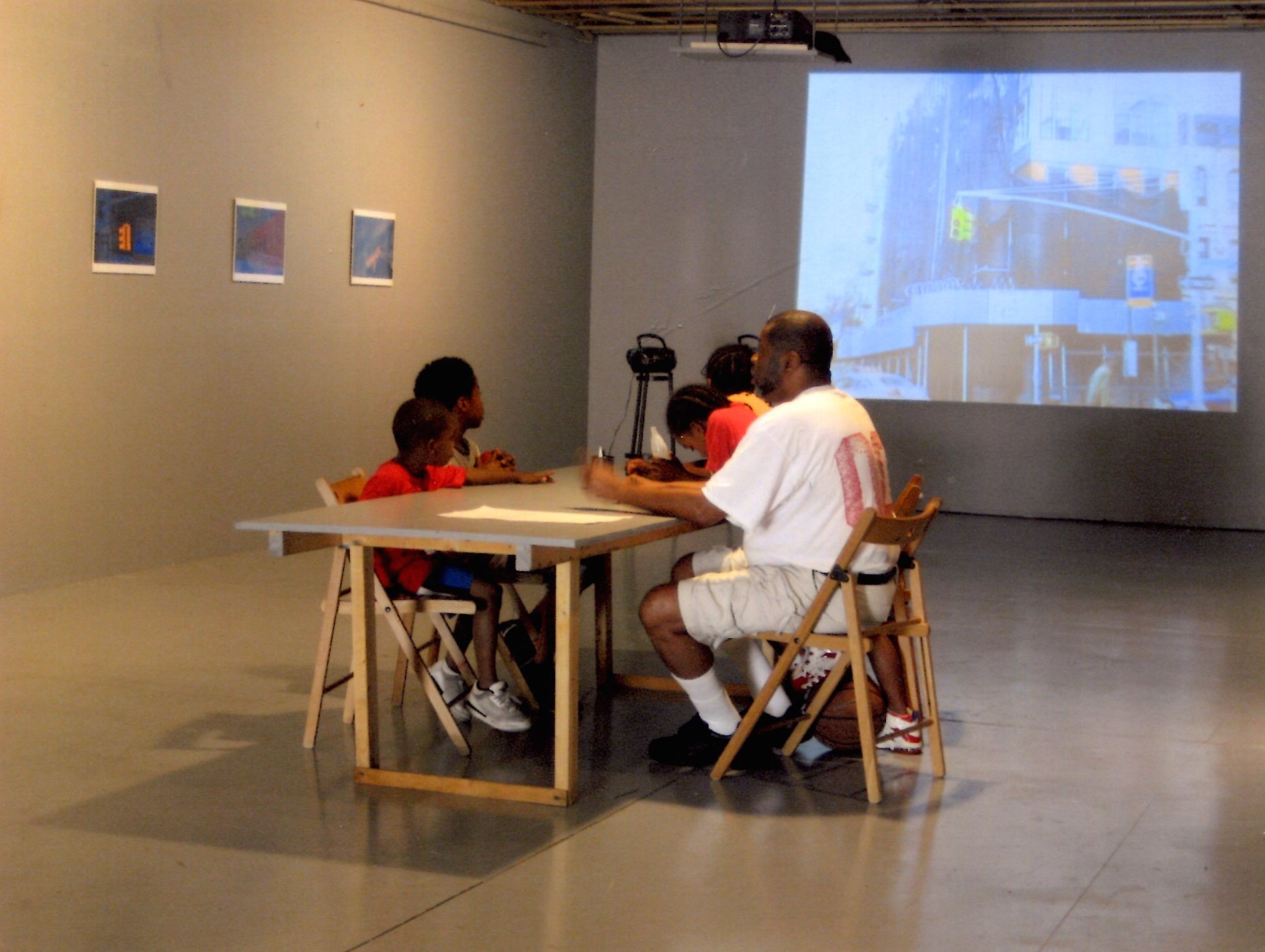 "Exhibition view of  There Goes the Neighborhood , a sound installation of ""voices from the other side of Brooklyn's real estate boom"", shown alongside photographs of Crown Heights by Michael Britto. 2007"