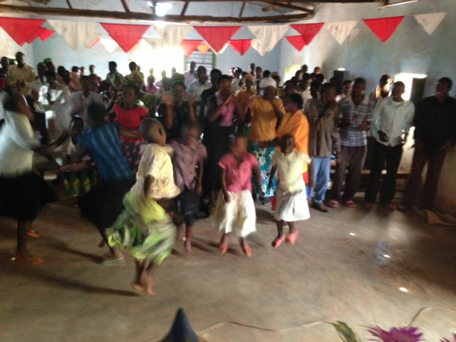 Local Bihembe children and church members singing and dancing at conclusion of a discussion of the philanthropic efforts from Cedar Falls Iowa, March 2013