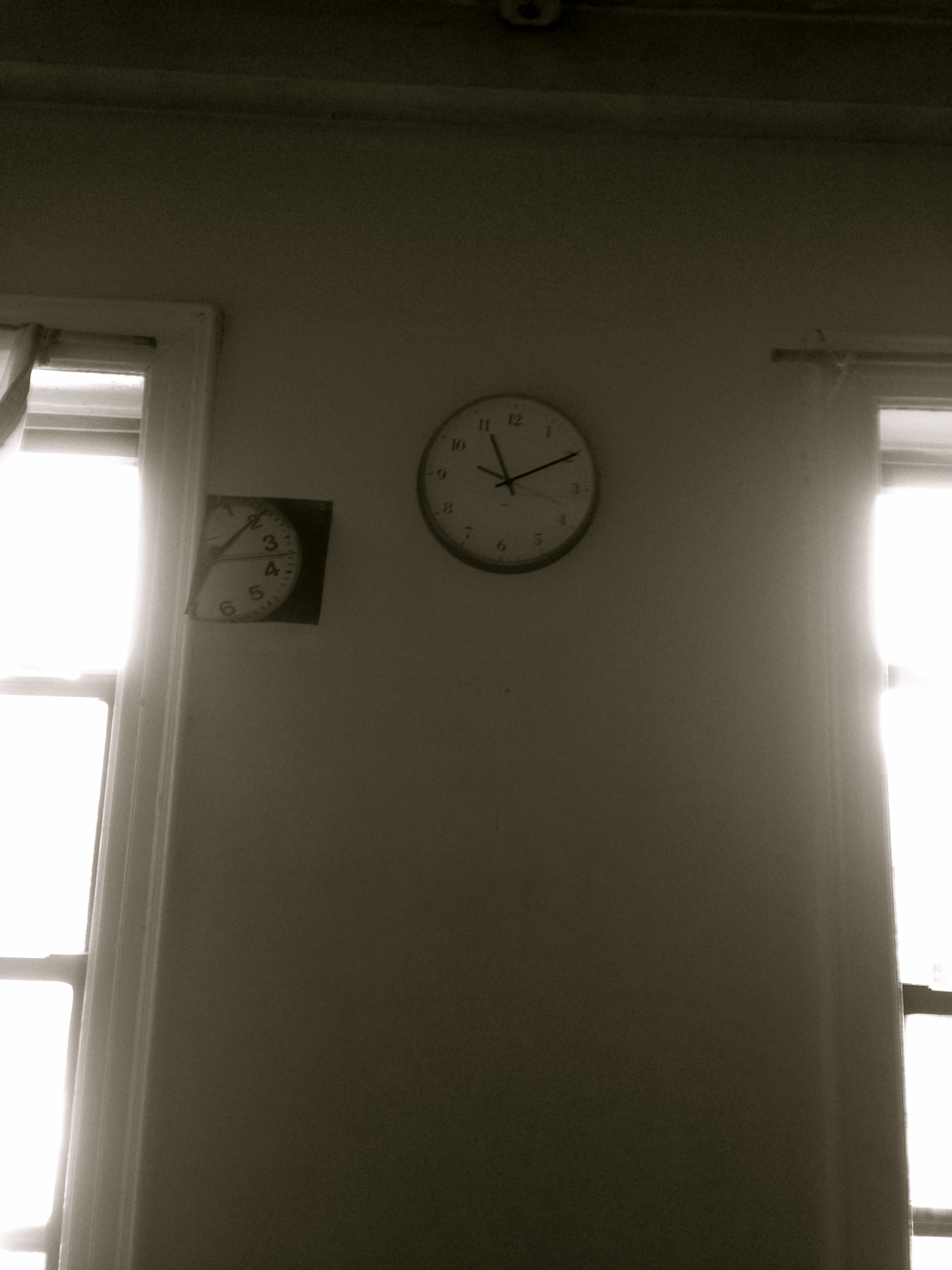 In the studio,  a picture of a clock next to an actual clock gives the latter some perspective.