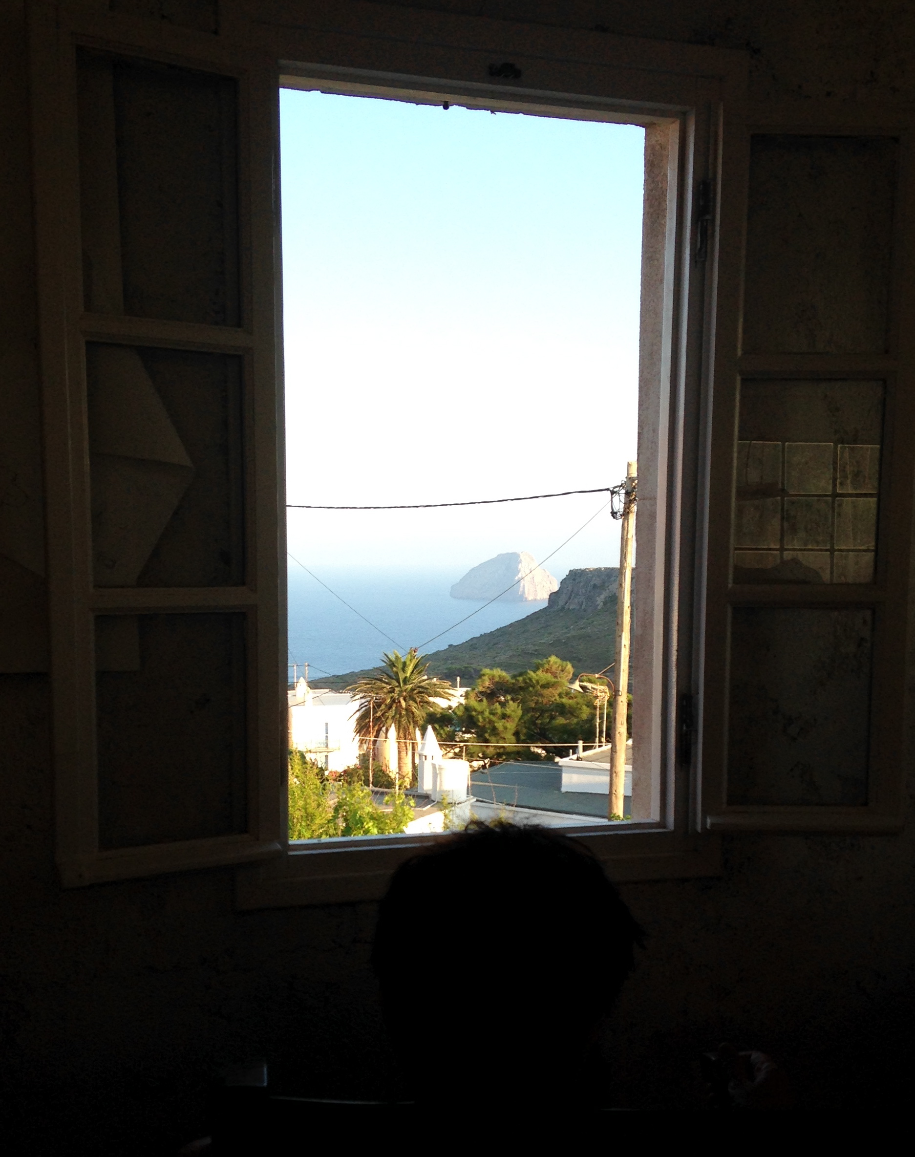 View from the thinking chair. The window looks over the town of Chora, and onto the small uninhabited island Avgo ('egg' in Greek).