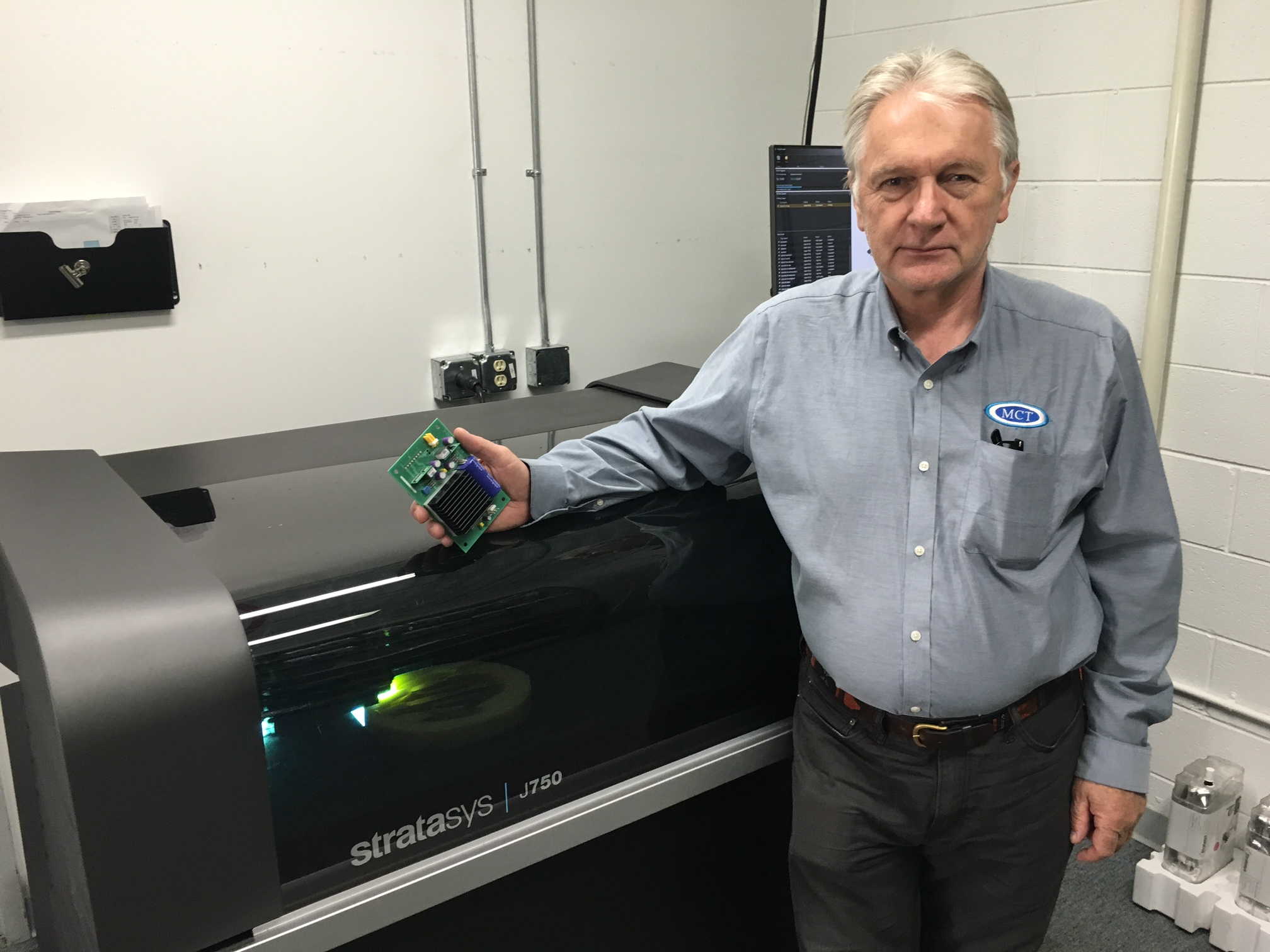 Midwest Composite Technologies' Helmut Keidel with his new Stratasys J750 full color 3D printer