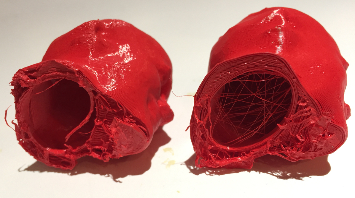 Two 3D printed Robert heads decapitated due to extreme bed adhesion