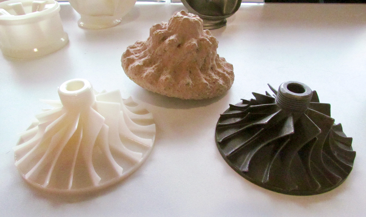 On the left, an object 3D printed in PolyCast; middle is the object encased in a casting medium; right is a solid cast metal object based on the original print