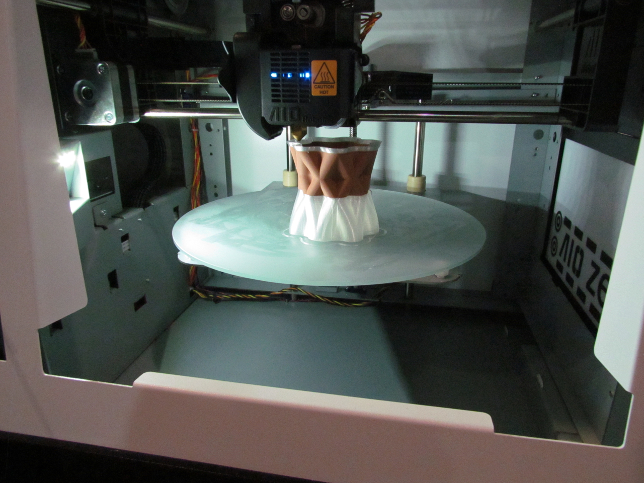 A circular 3D print surface on the AIO Robotics ZEUS machine