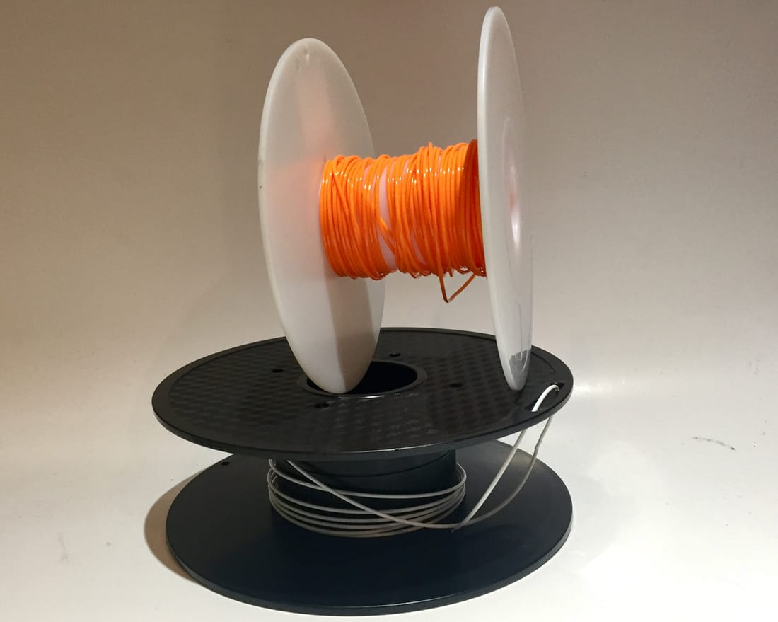 3D printer spools with not a lot of filament left on them