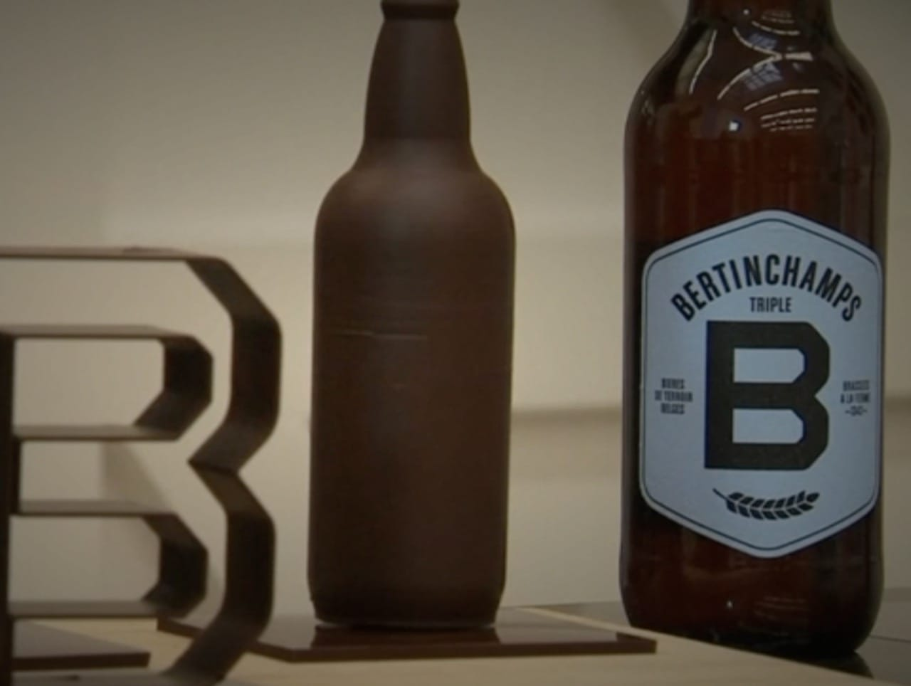 A life-size 3D printed chocolate beer bottle