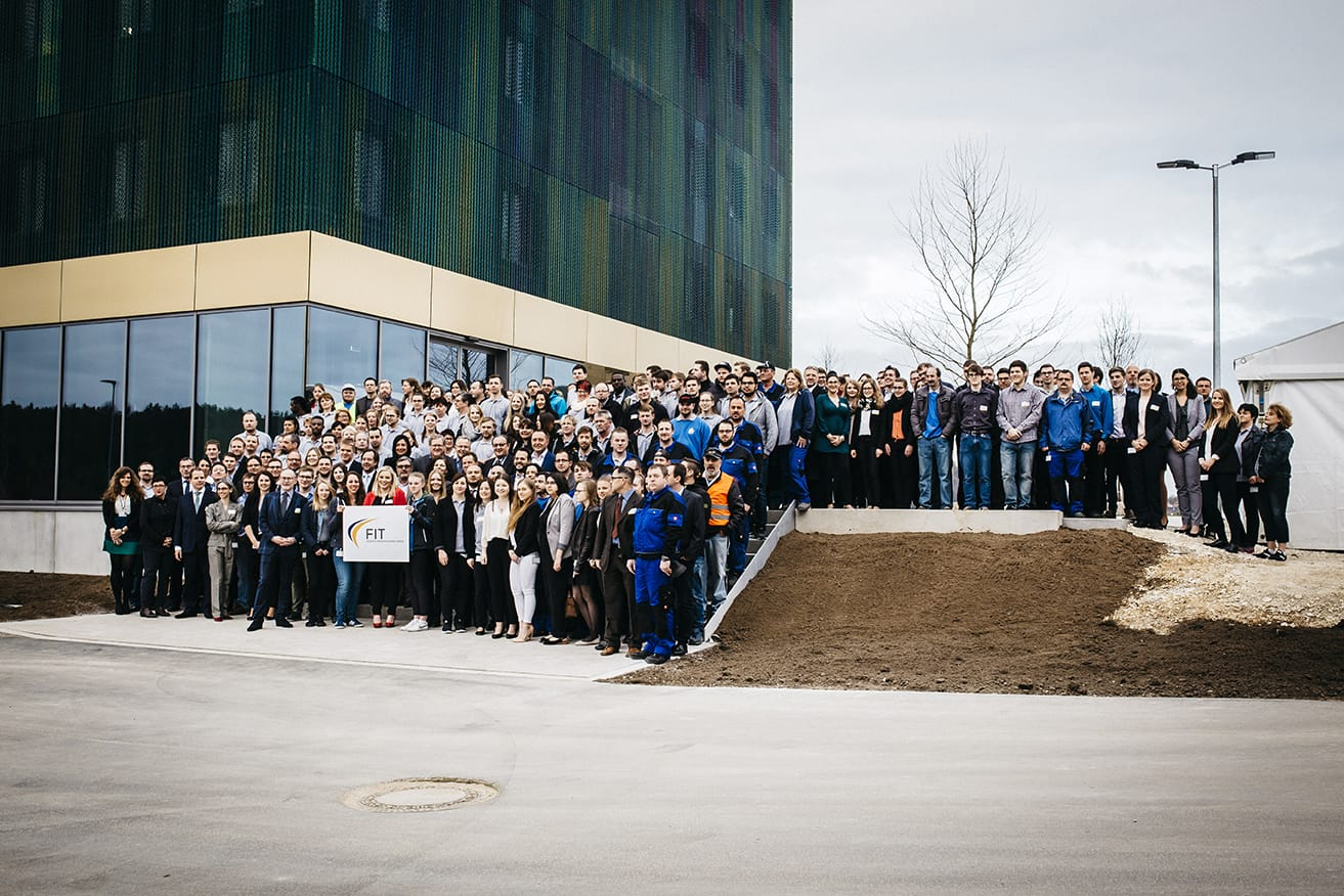 Outside FIT AG's new additive manufacturing centre, with some of their team