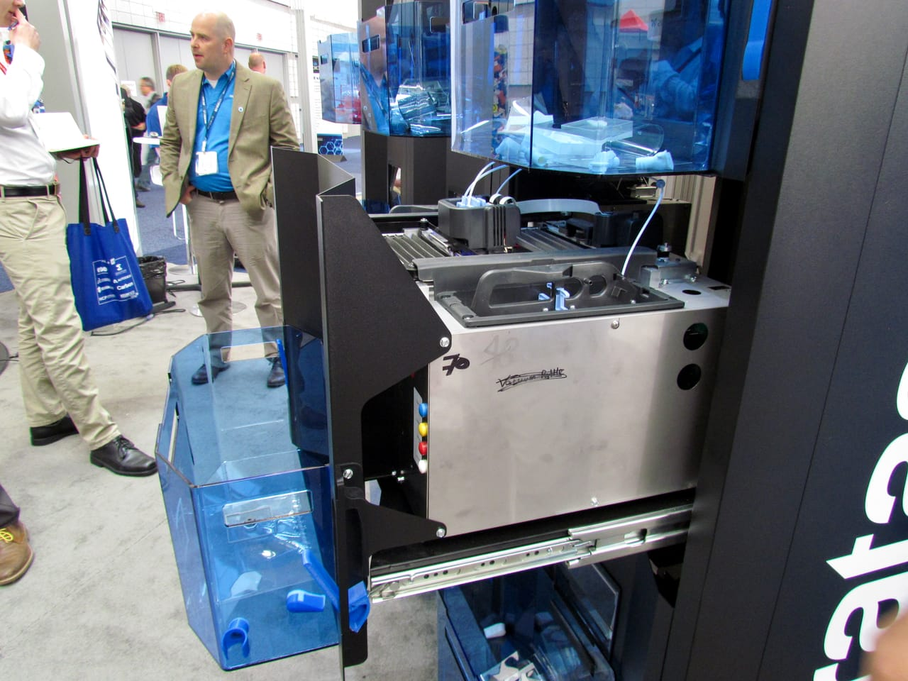 An open cell in Stratasys' Continuous Build Demonstrator with blue bin to catch completed 3D prints