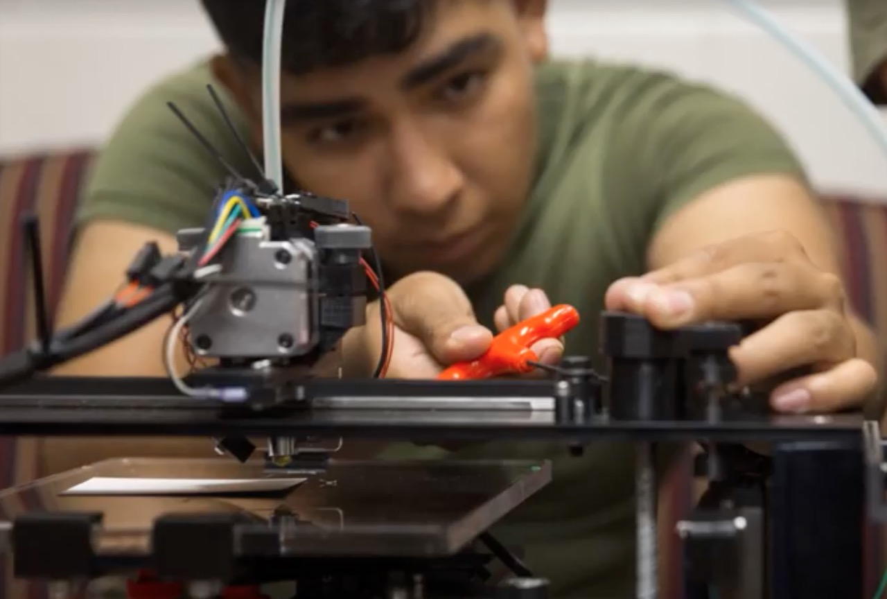 A US Marine working in the X-FAB, a prototype mobile 3D print workshop