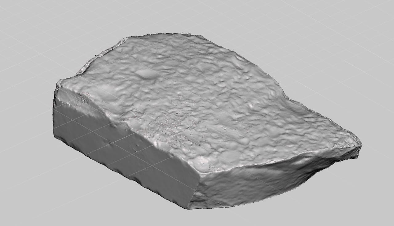 The back side of the Rosetta Stone 3D model, showing a rough, rocky surface