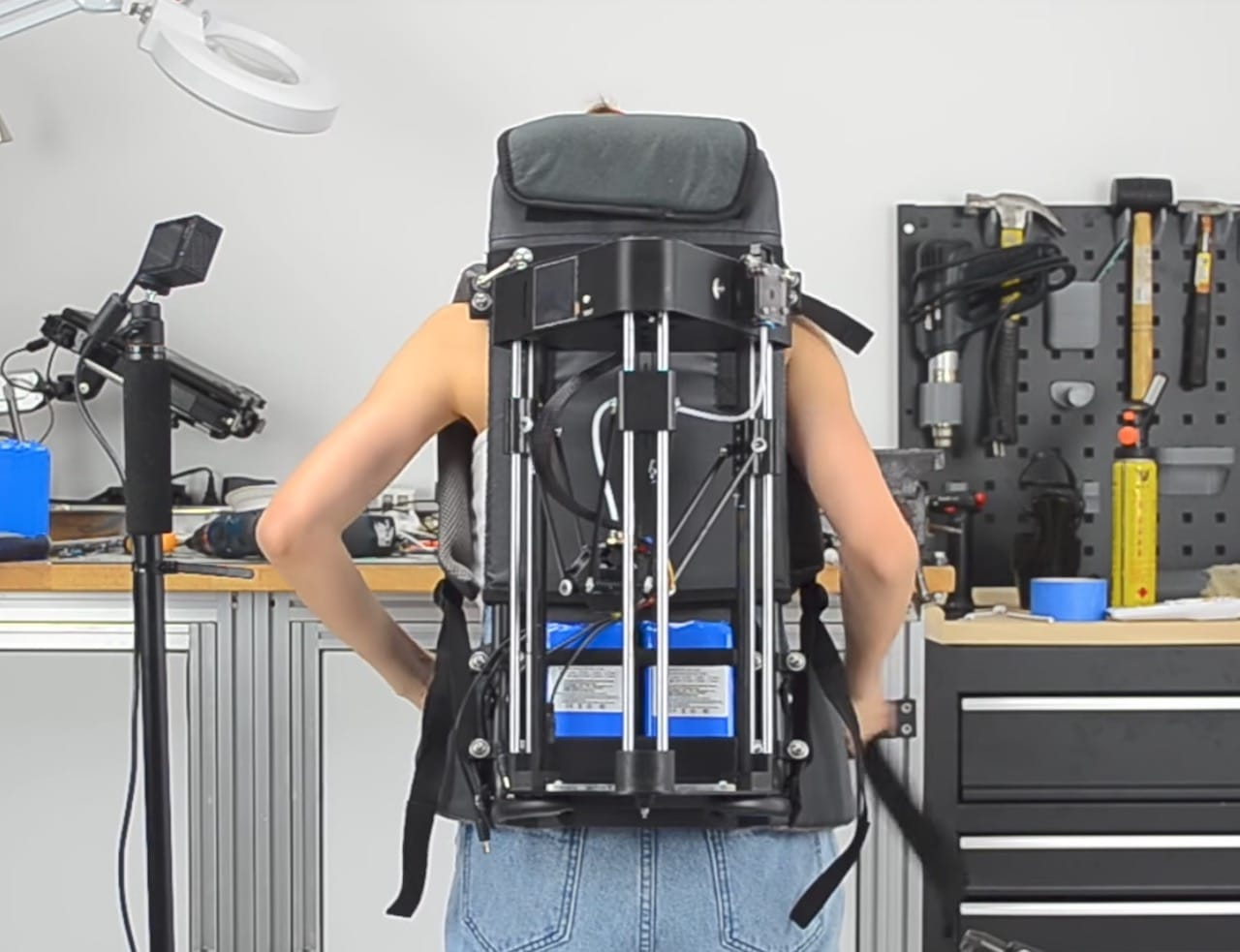 The 3D printer is literally mounted on Naomi Wu's back