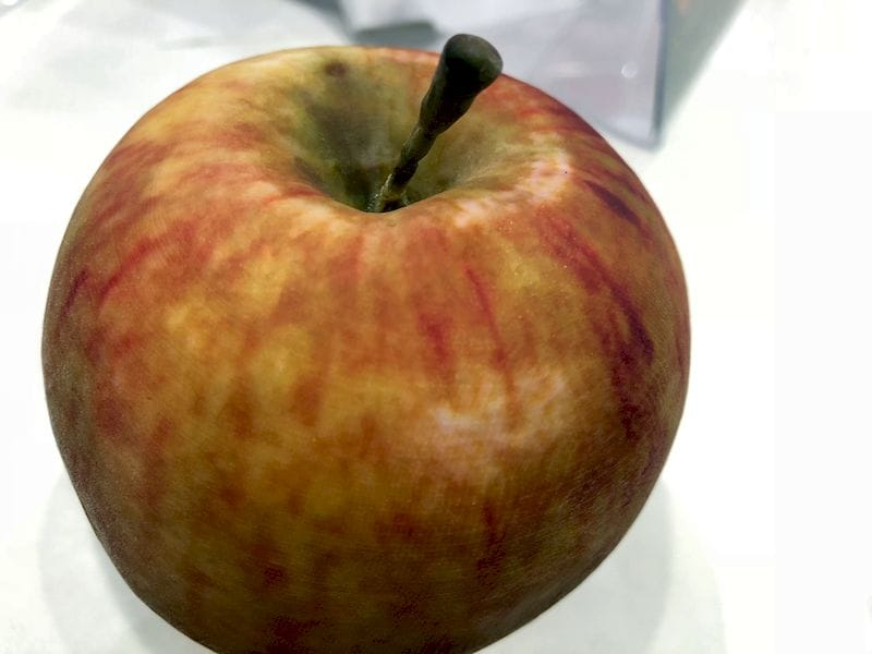An ultra-realistic 3D printed apple made with Stratasys' GrabCAD VoxelPrint